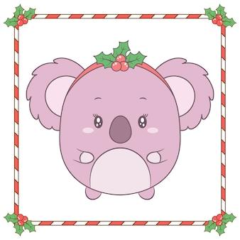 Joyeux noël dessin animal mignon avec cadre de fruits rouges et de bonbons