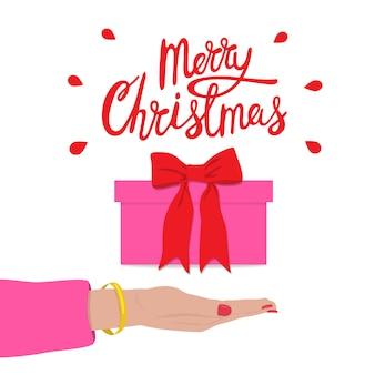 Joyeux noël félicitation avec boîte-cadeau et main féminine. vente de vacances