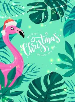 Joyeux noël main lettrage texte pour la célébration du nouvel an exotique. oiseau flamant rose aux feuilles tropicales.