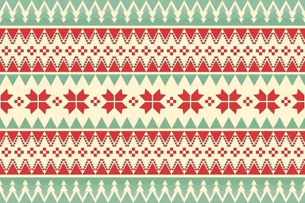 Joyeux noël motif ethnique sans couture vintage décoré d'arbres verts et de fleurs rouges. conception pour le fond, le papier peint, le tissu, le tapis, la bannière web, le papier d'emballage. style de broderie. vecteur.