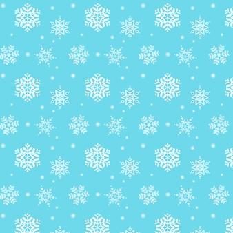 Joyeux noël. motif flocon de neige sur fond bleu