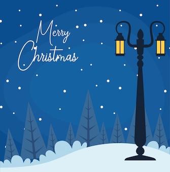 Joyeux noël avec paysage de nuit d'hiver avec lampadaire