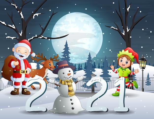 Joyeux noël avec le père noël et l'elfe dans le paysage de nuit d'hiver