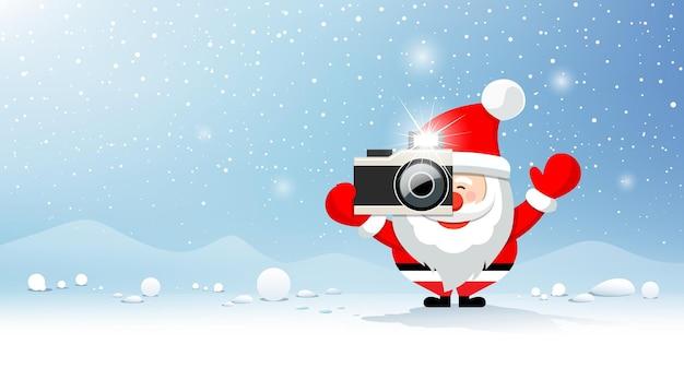 Joyeux noël père noël photographe sur la neige