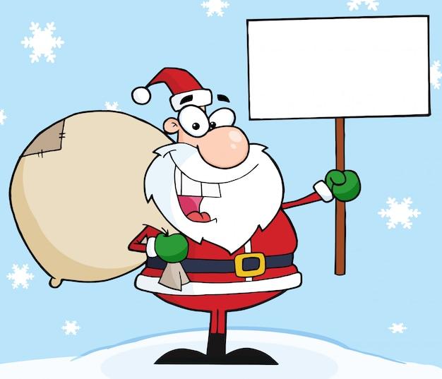 Joyeux noël santa tenant une pancarte blanche dans la neige