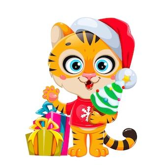 Joyeux noël tigre de personnage de dessin animé mignon en bonnet de noel debout près de coffrets cadeaux