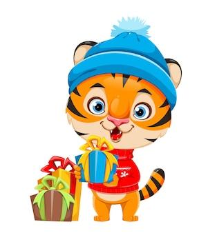 Joyeux noël tigre de personnage de dessin animé mignon dans un chapeau chaud tenant une boîte-cadeau