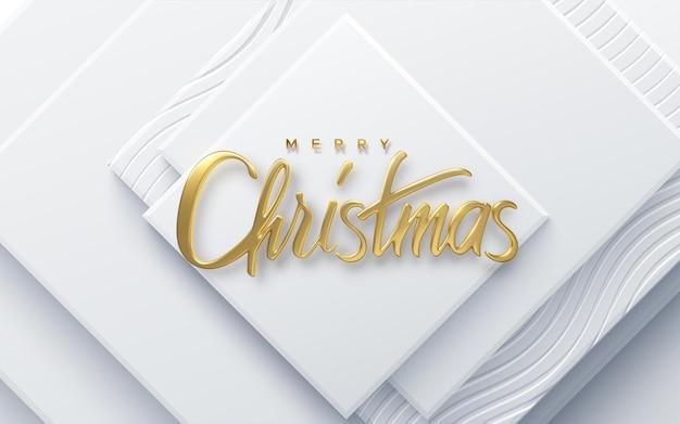Joyeux noël vacances signe de lettrage d'or sur fond de papier blanc coupé