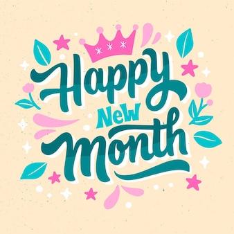 Joyeux nouveau mois lettrage avec des éléments dessinés à la main