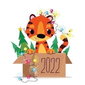 Joyeux nouvel an chinois 2022 petit tigre dans une boîte année de l'animal du zodiaque