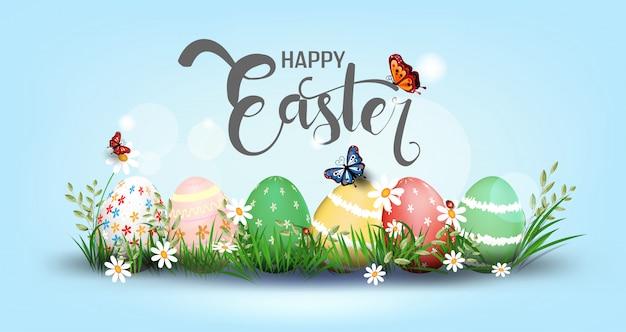 Joyeux pâques élément pour design.eggs dans l'herbe verte avec des fleurs blanches isolées