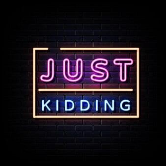 Just kidding neon sign sur mur de briques noires