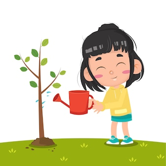Kid arrosant l'arbre