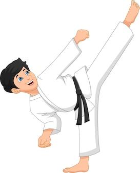 Kid karaté kick pose sur fond blanc