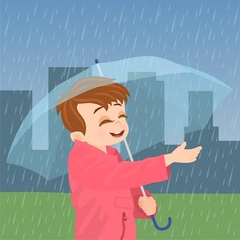 Kid avec un parapluie debout sous la pluie
