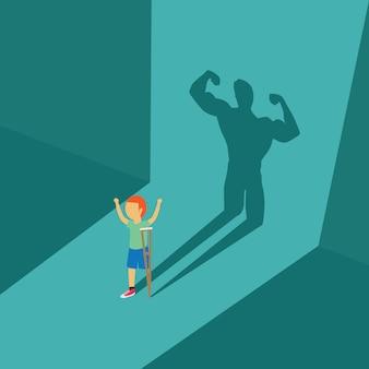 Kid avec son handicap ont une ombre d'homme puissant