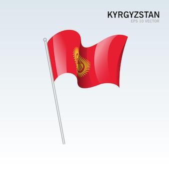 Kirghizistan, agitant le drapeau isolé sur gris