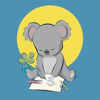 Koala assis et dessin avec des crayons de couleur