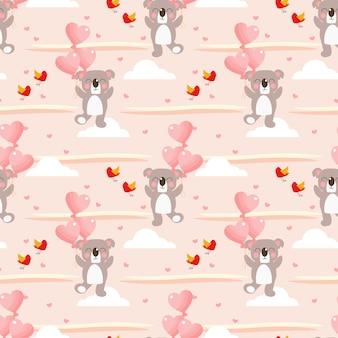 Koala mignon et modèle sans couture de ballon en forme de coeur.