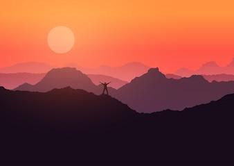 L'homme se tenait sur le paysage de montagne au coucher du soleil