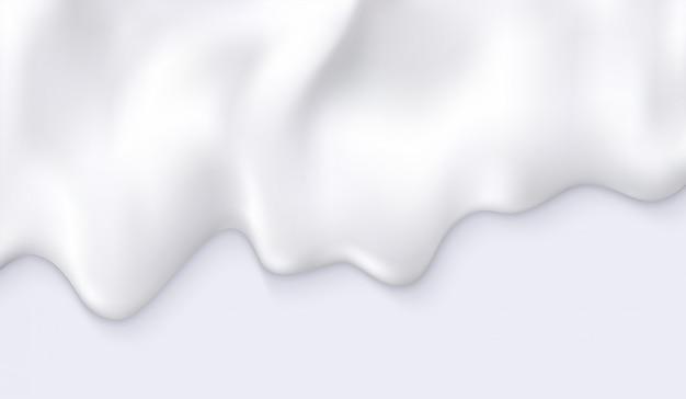 Le lait blanc crémeux coule. fond de produit cosmétique ou de l'industrie alimentaire.