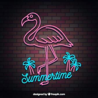 Lampe au néon flamingo avec des éléments de plage