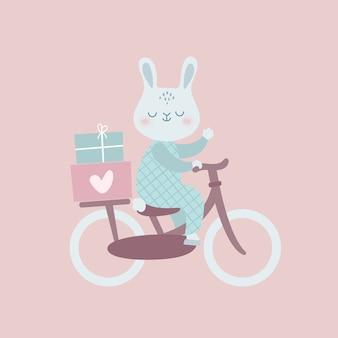 Lapin drôle à vélo avec des cadeaux