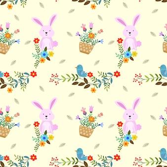 Lapin mignon avec des fleurs et modèle sans couture oiseau.