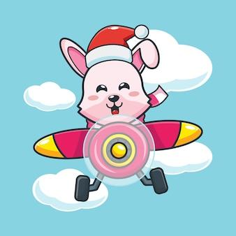 Lapin mignon portant un bonnet de noel voler avec un avion le jour de noël illustration de dessin animé mignon de noël