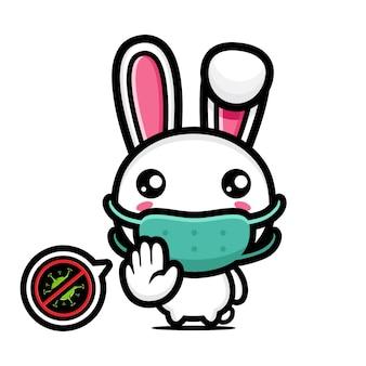 Lapin mignon portant un masque avec une pose de virus d'arrêt