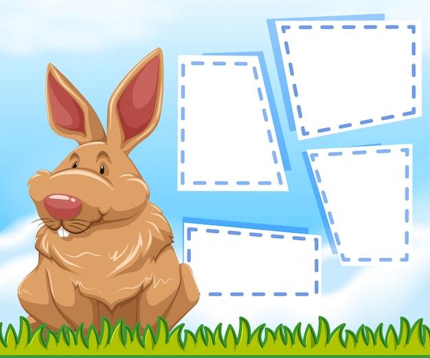 Un lapin sur un modèle de note
