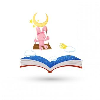 Le lapin qui se balance avec le livre de l'horoscope