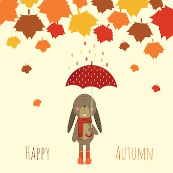 Lapin sous un parapluie en saison d'automne