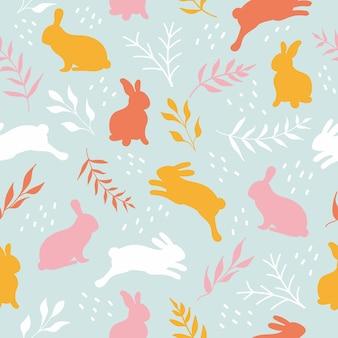 Lapins dessinés à la main mignons dans un modèle sans couture de pâques de pré de fleurs avec des lapins et des brunchs