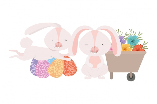 Lapins avec icône de brouette et oeuf de pâques