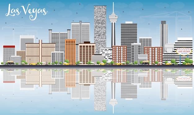 Las vegas skyline avec bâtiments gris, ciel bleu et reflets.