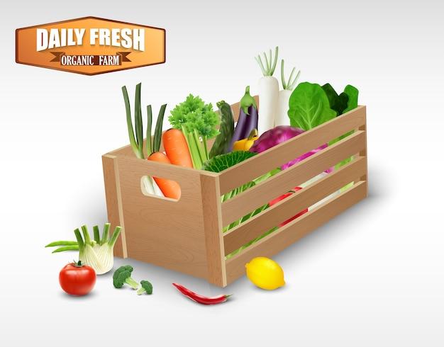 Légumes frais dans des caisses en bois sur fond blanc