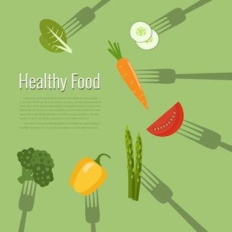 Légumes et fruits sur des fourchettes alimentation saine