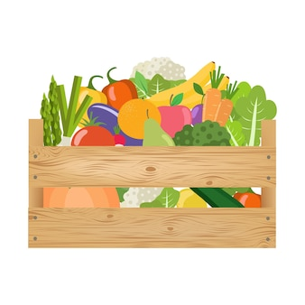 Légumes et fruits frais et sains dans une boîte en bois.