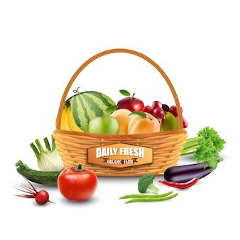 Légumes et fruits en panier d'osier isolé sur blanc