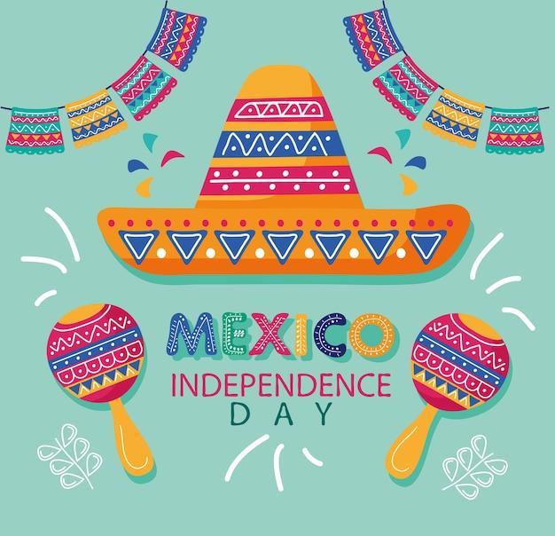 Lettrage de célébration de la fête de l'indépendance du mexique avec chapeau de mariachi et maracas