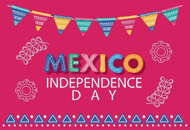 Lettrage de célébration de la fête de l'indépendance du mexique avec des fleurs et des guirlandes