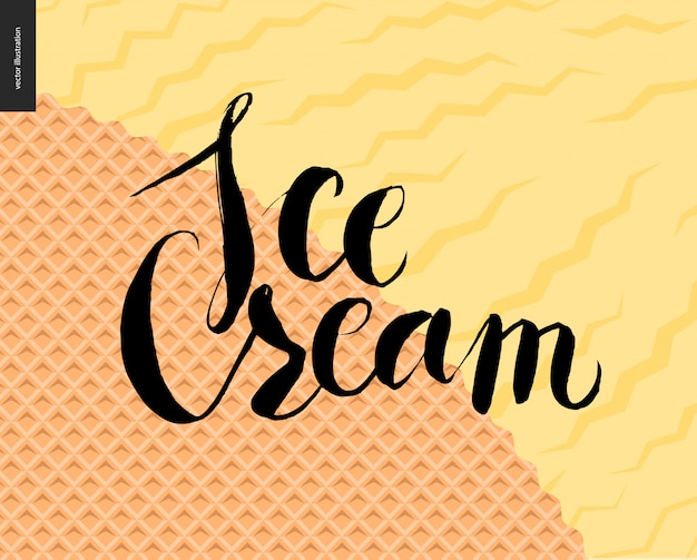 Lettrage de crème glacée sur une glace jaune et une gaufre