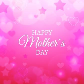 Lettrage de la fête des mères floue avec des étoiles et des coeurs