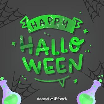 Lettrage d'halloween joyeux vert avec des potions