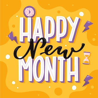 Lettrage `` happy new month '' avec des éléments dessinés à la main
