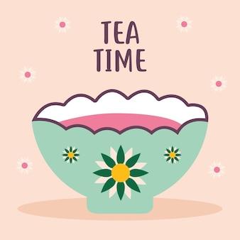 Lettrage de l'heure du thé avec tasse verte de café et de fleurs