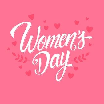 Lettrage de la journée des femmes avec des coeurs