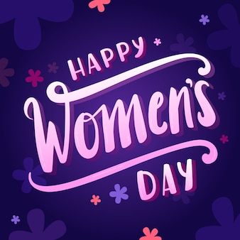 Lettrage de la journée des femmes sur fond bleu foncé