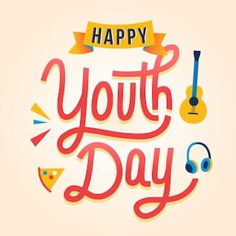 Lettrage de la journée de la jeunesse heureuse avec guitare